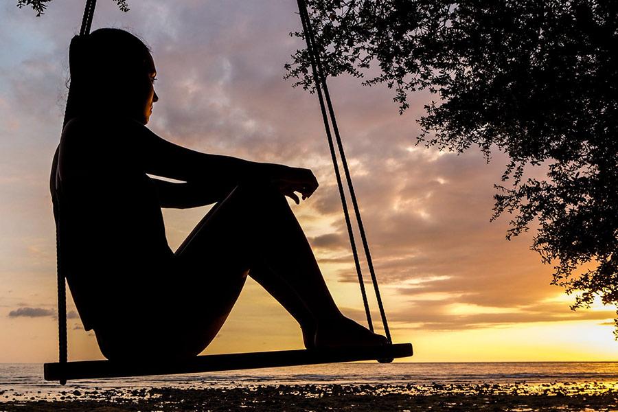 Woman enjoys sunset
